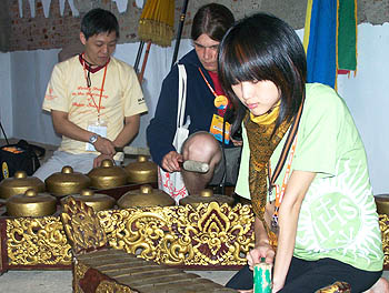 Polish and Taiwan youths try out traditional musical instruments while in Cigugur, Indonesia, on July 7, during a project to foster Ignatian spirituality among youths participating in this year's international WYD celebration.