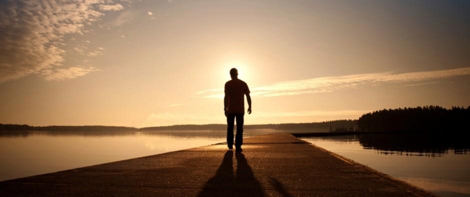 Man-walking-sunset-396-940x394