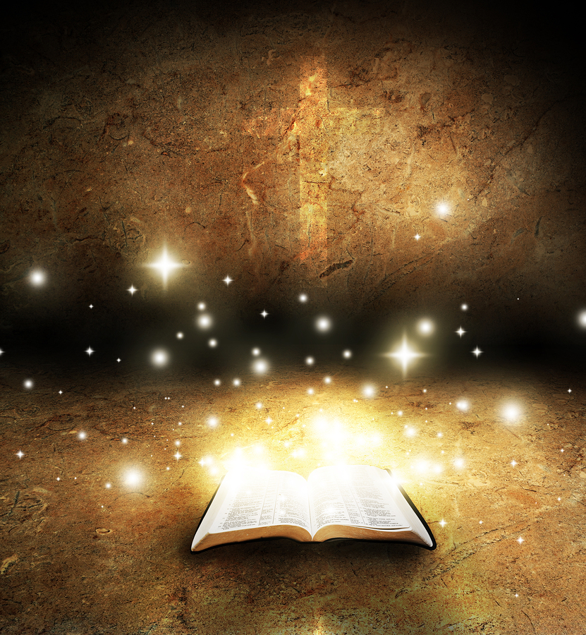 bigstock-open-bible-glowing-with-cross-26156423