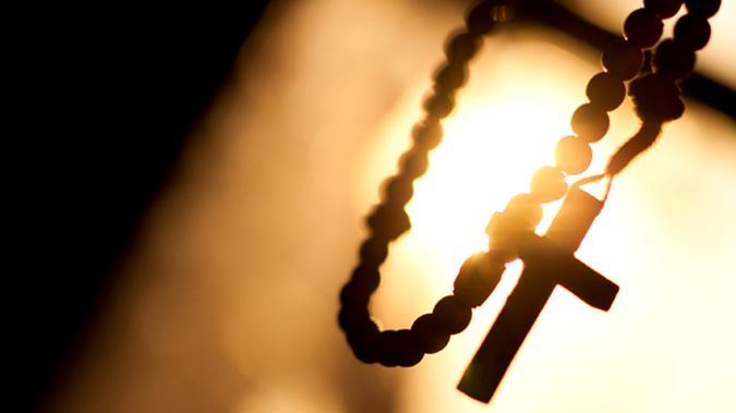 rosary-beads-cross-catholic-church-istock