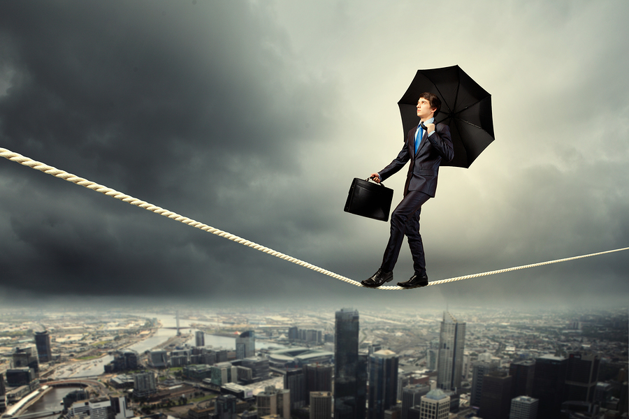 Image of pretty businessman balancing on rope